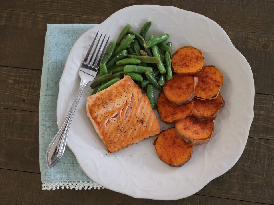 Plate with salmon, sweet potatoes and green beans