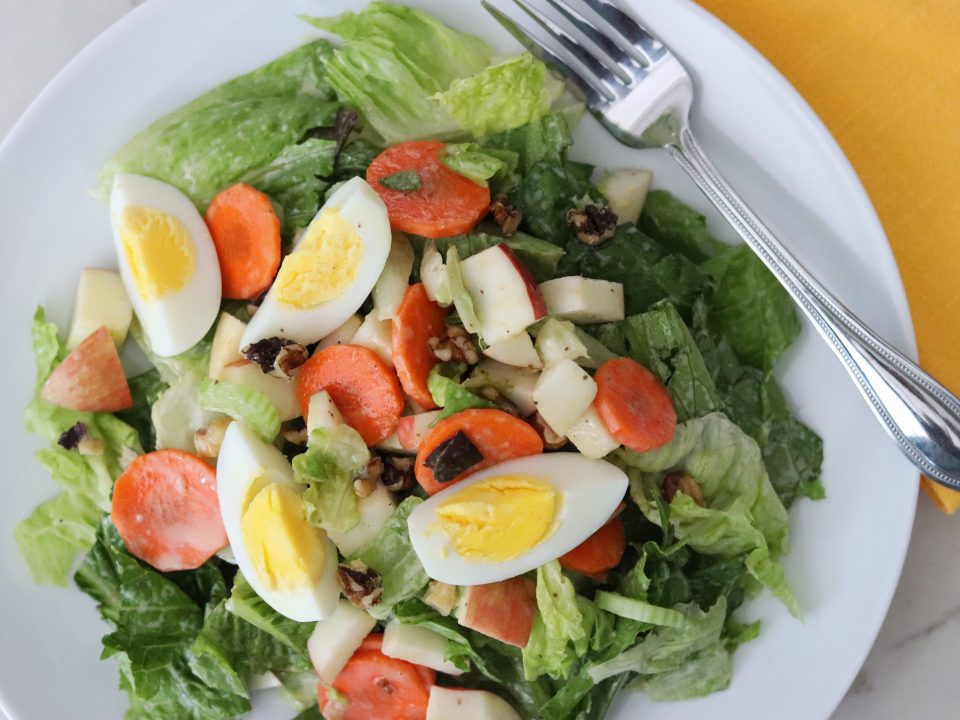 Plate with Fall Salad with Honey-Mustard Dressing and Boiled Egg, featuring romaine lettuce, celery, carrot, and apple