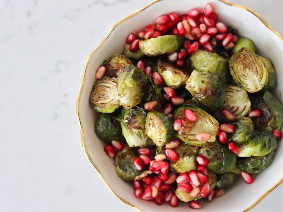 A bowl of Roasted Brussels Sprouts with Balsamic and Pomegranate Seeds
