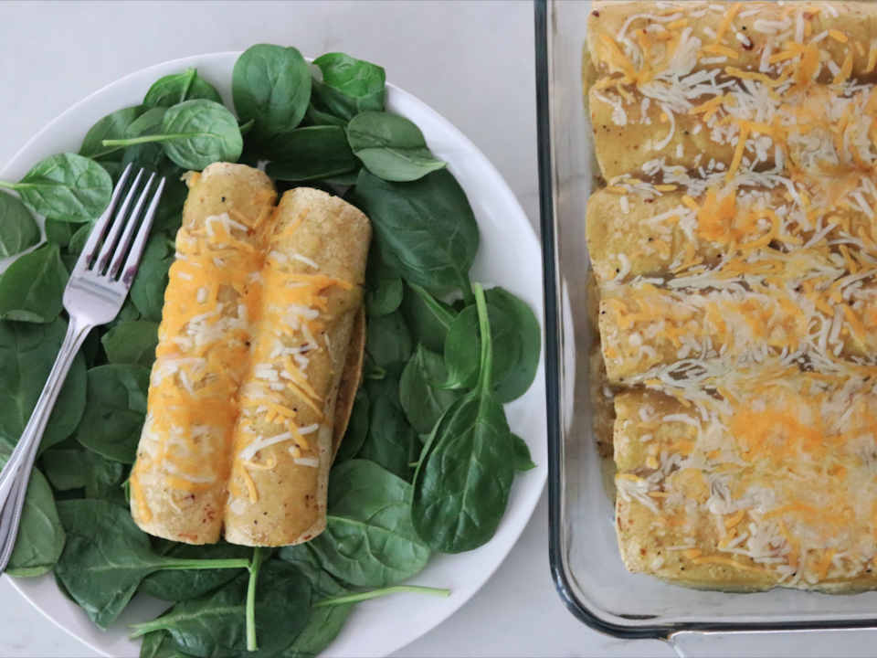 Plate of Leftover Turkey and Spinach Enchiladas with pan in the background