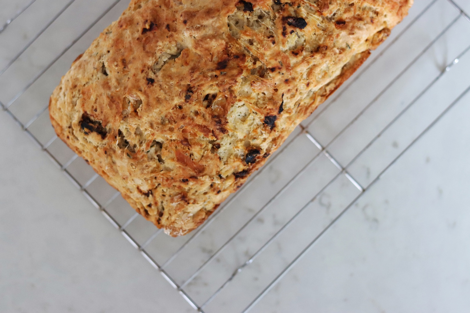 Cheesy Sun-Dried Tomato Beer Bread loaf from overhead