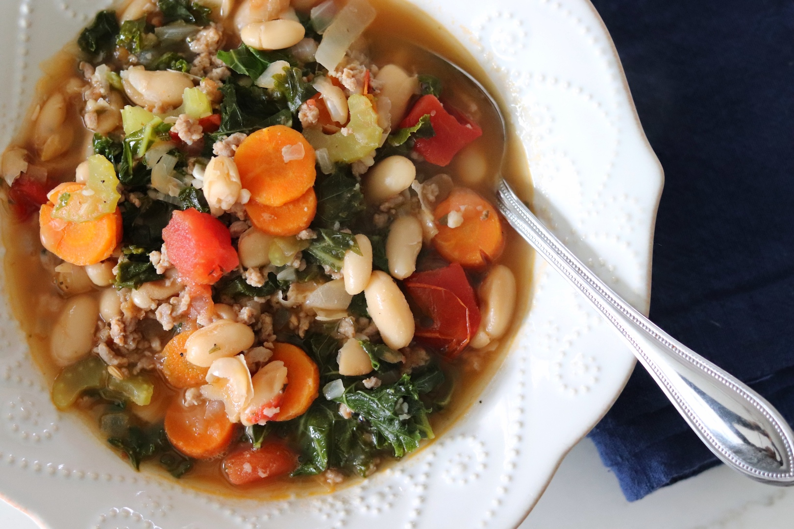 A bowl of Italian Turkey Sausage, Kale and White Bean Soup