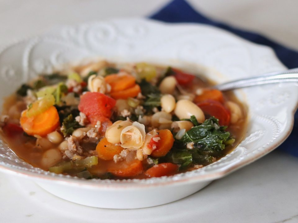 A bowl of Italian Turkey Sausage, Kale, and White Bean Soup