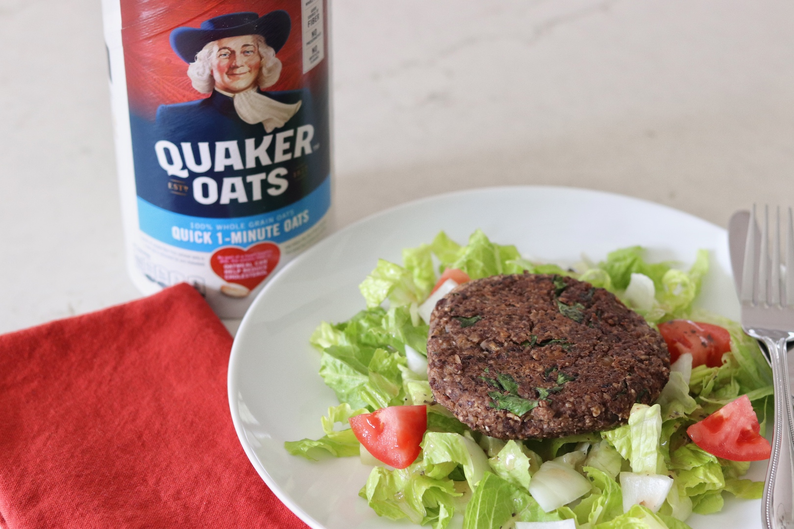 Quaker Oat Black Bean Vegetable Burger on a salad