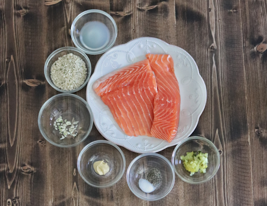 Ingredients for Salmon Burgers, including raw salmon, panko breadcrumbs, lemon juice, dill pickle relish, Dijon mustard, salt and pepper