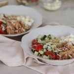 Instant Pot Greek Chicken Gyro Bowls with ingredients in the background