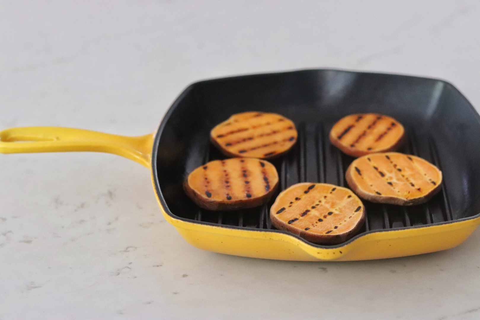 Sweet Potato Slider Buns in a yellow grill pan