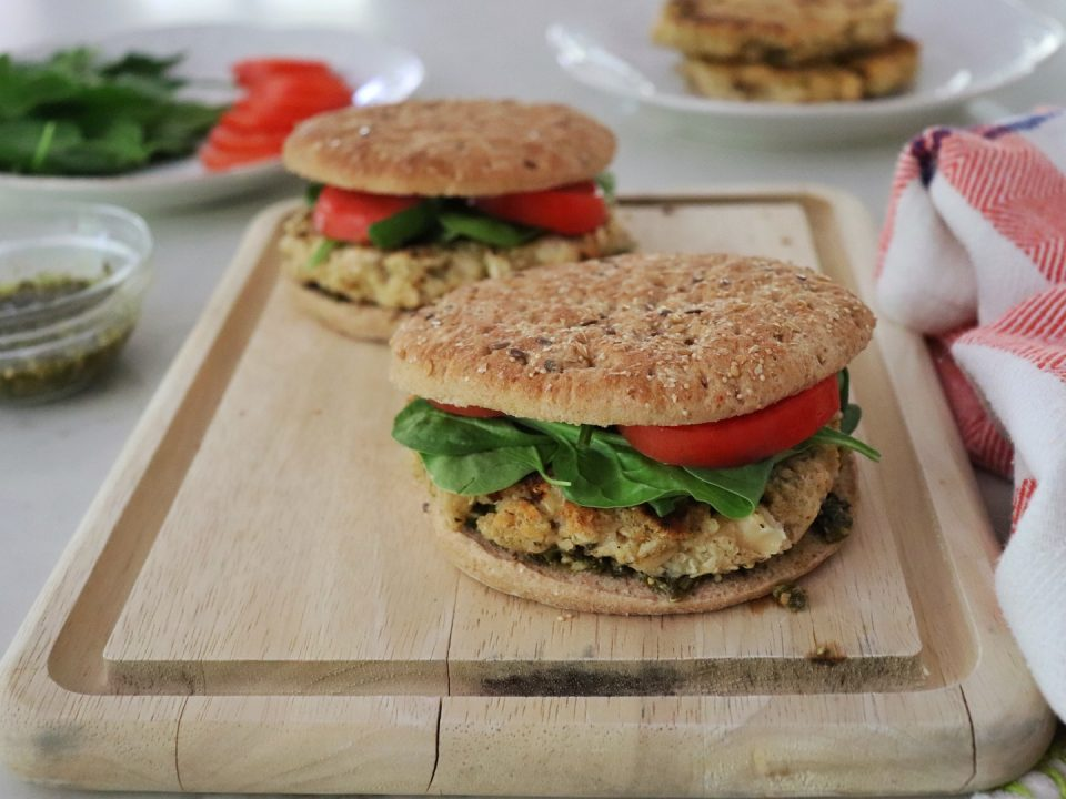 Flaxseed Quinoa and White Bean Burgers on a wooden cutting board