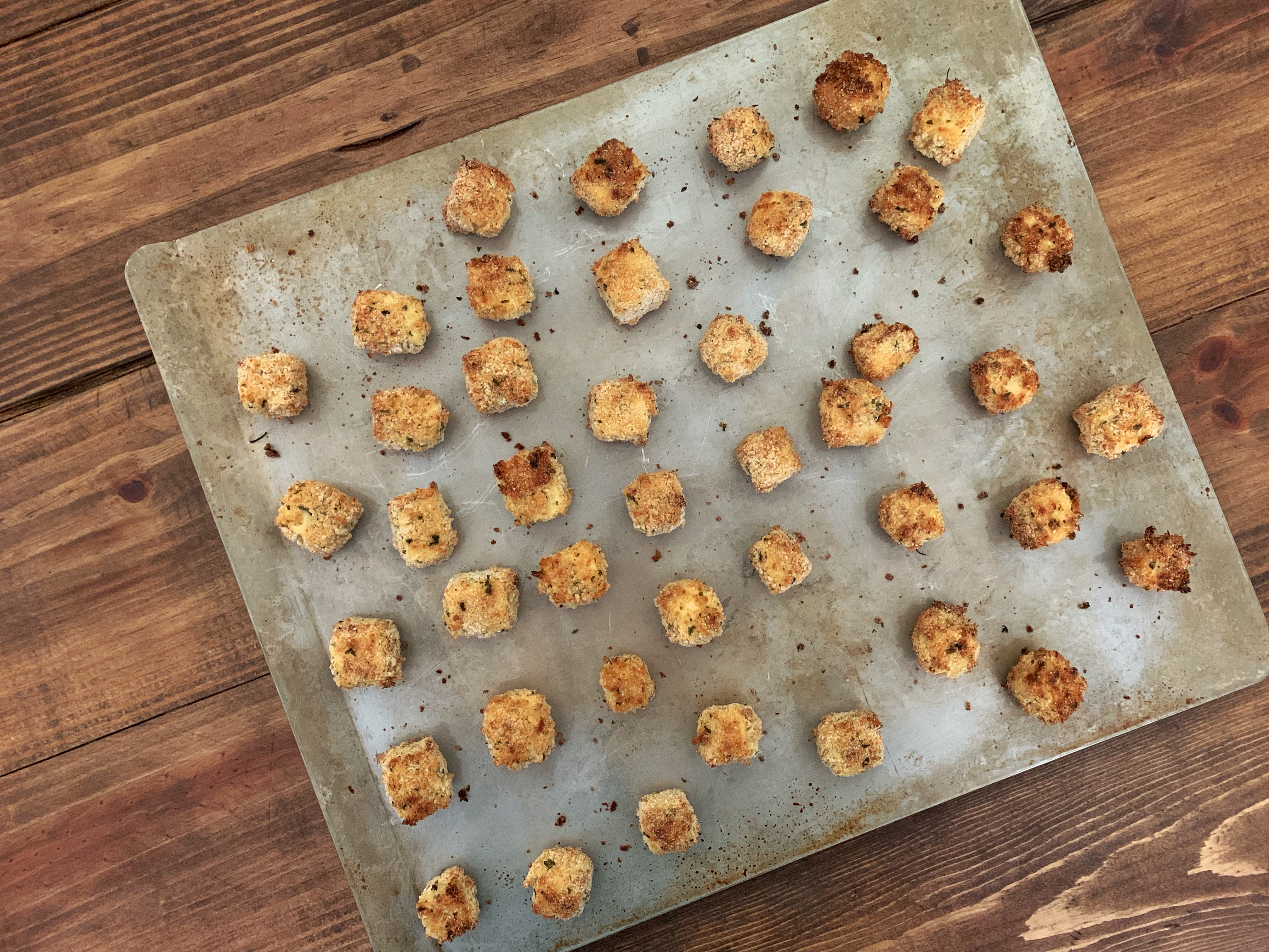Crispy Oven Fried Tofu Nuggets on a sheet pan after baking
